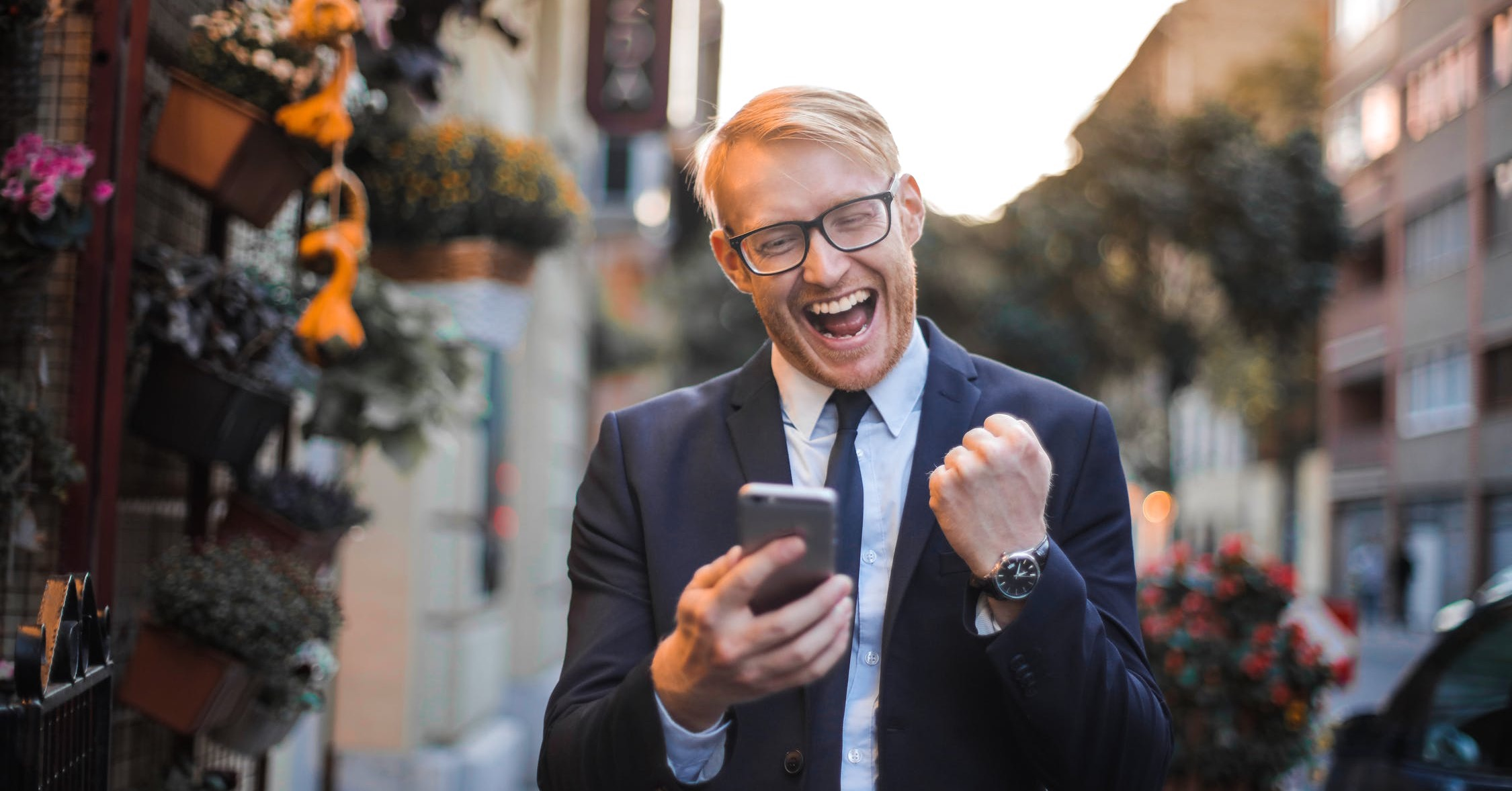 Happy man with mobile phone