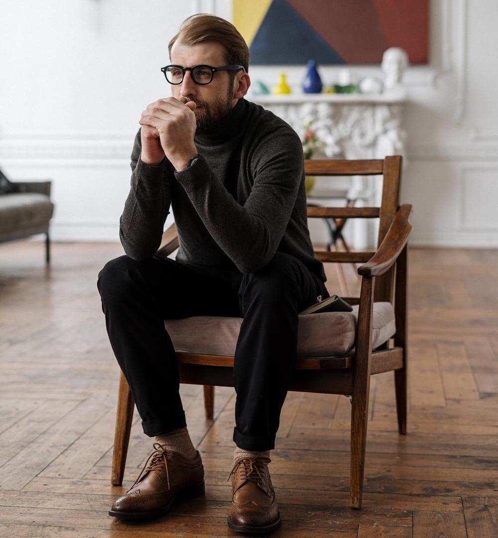 Peacefull man sitting in a chair.